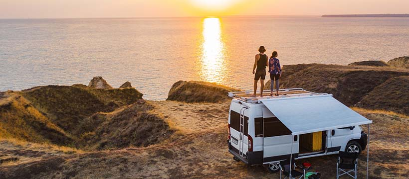 RV on beach during a sunset